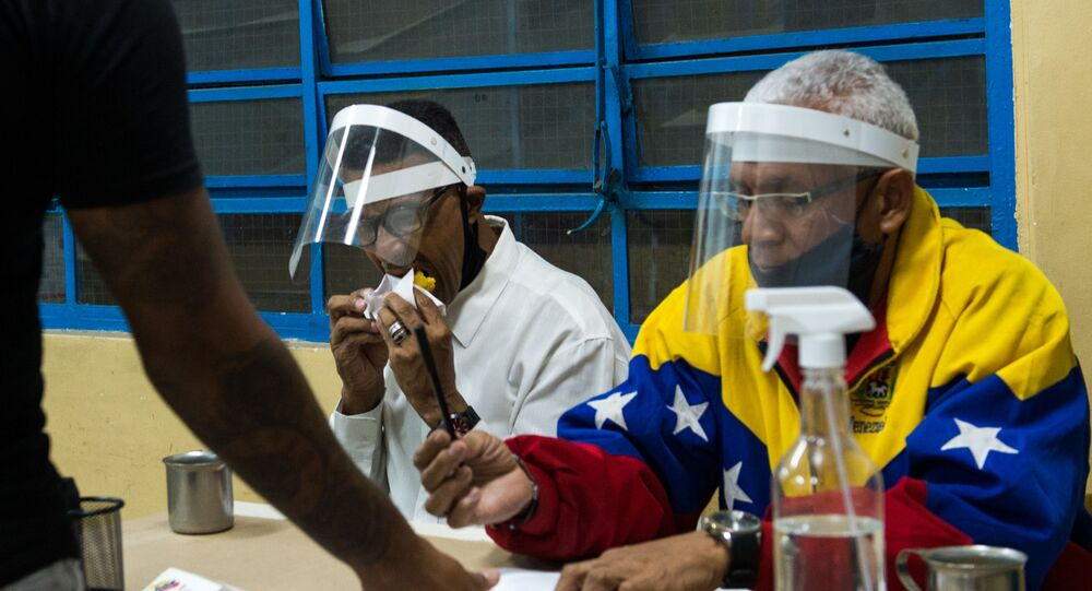 A man casts his vote at a polling station in a school in Caracas, on December 6, 2020 during Venezuela's legislative elections.