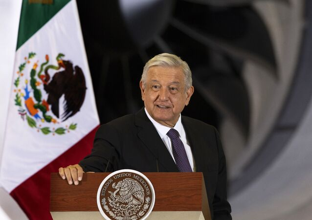 In this July 27, 2020 file photo, Mexican President Andres Manuel Lopez Obrador gives his daily, morning press conference in front of the former presidential plane that has been for sale since he took office, at Benito Juarez International Airport in Mexico City