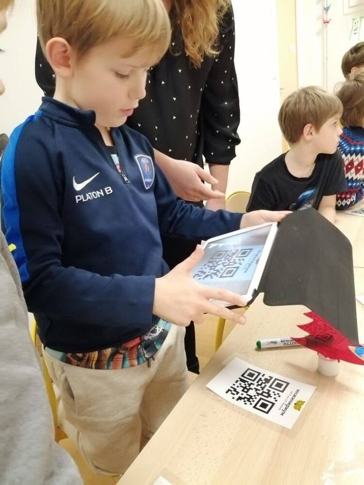 A boy takes part in a workshop on circuit engineering in Paris, France.