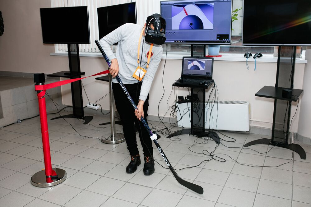 Composite Battle VR World Cup helps a pupil to play virtual hockey.