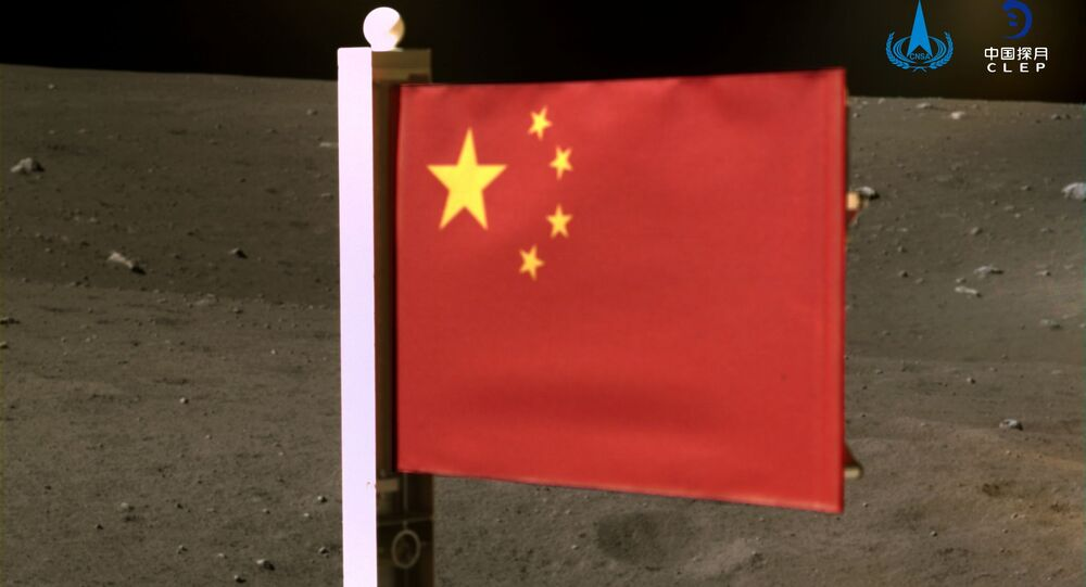 China's national flag is seen unfurled from the Chang'e-5 spacecraft on the moon, in this handout image provided by China National Space Administration (CNSA) December 4, 2020.