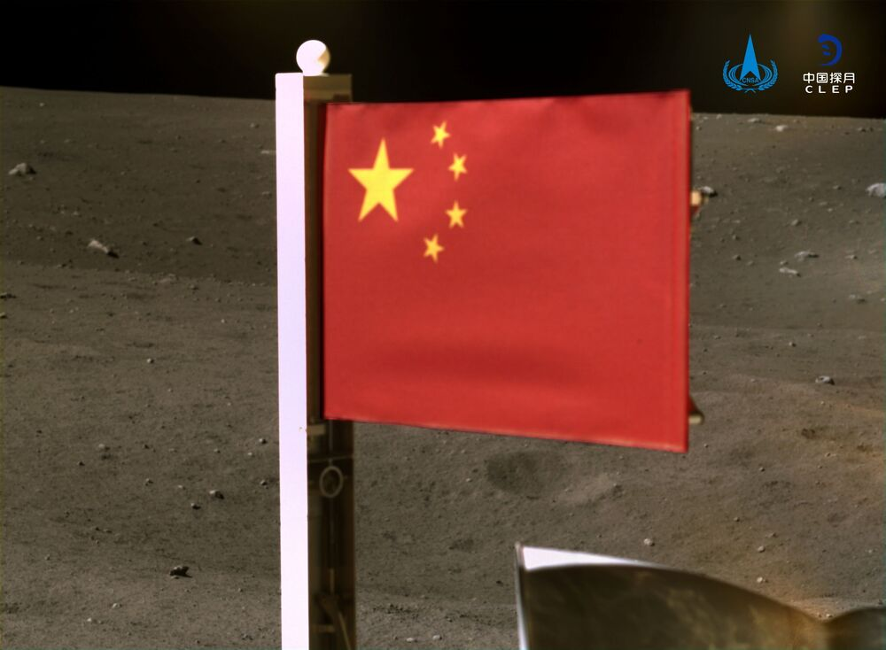 China's national flag is seen unfurled from the Chang'e-5 spacecraft on the moon, in this handout image provided by China National Space Administration (CNSA) 4 December 2020.