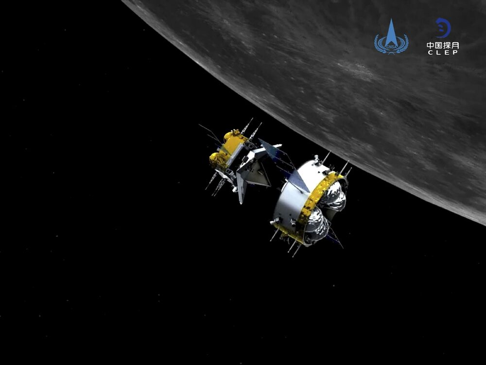 This graphic simulation image provided by China National Space Administration shows the orbiter and returner combination of China's Chang'e-5 probe after its separation from the ascender, at the Beijing Aerospace Control Center (BACC) in Beijing Sunday, 6 December 2020. The Chinese probe that landed on the moon transferred rocks to an orbiter Sunday in preparation for returning samples of the lunar surface to Earth for the first time in almost 45 years, the country's space agency announced.