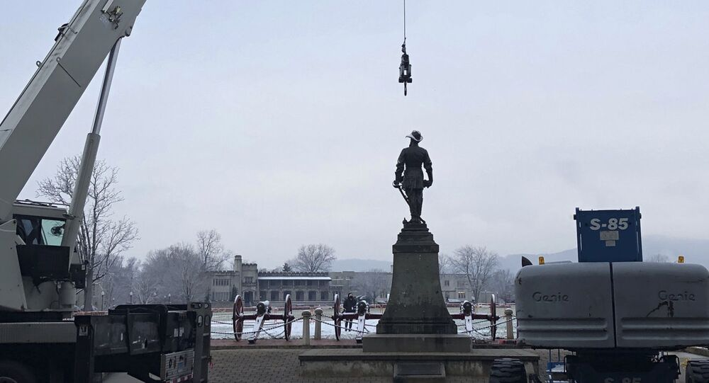 Crews prepare to remove a statue of Confederate Gen. Thomas Stonewall Jackson from the campus of the Virginia Military Institute on Monday, Dec. 7, 2020, in Lexington, Va.