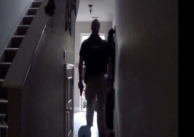 Screenshot captures an unidentified law enforcement official walking through the home of Rebekah Jones, a data scientist who was dismissed from the Florida Department of Health over alleged insubordination. A raid was conducted at Jones' residence in response to a complaint issued by her former employer in early November.
