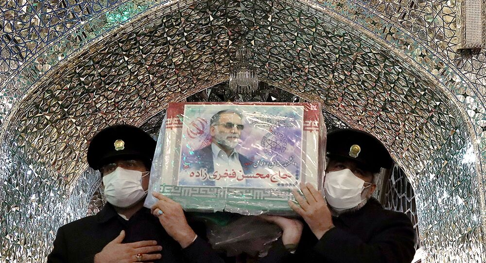Servants of the holy shrine of Imam Reza carry the coffin of Iranian nuclear scientist Mohsen Fakhrizadeh, in Mashhad, Iran, 29 November 2020.
