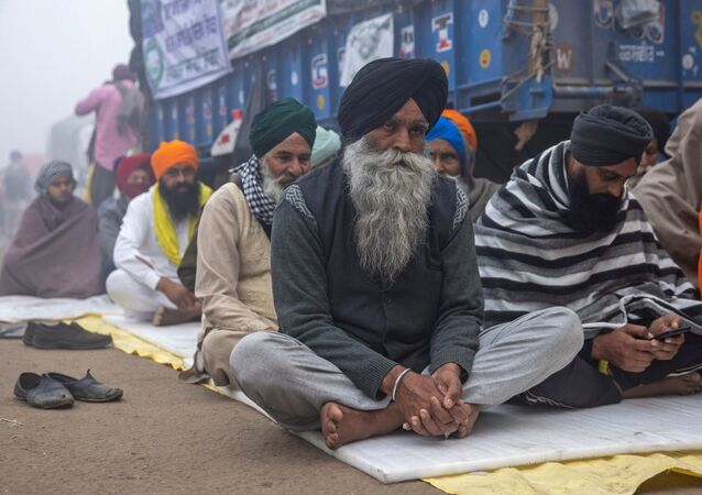 Farmers attend a nationwide protest against the newly passed farm bills on a foggy morning at Singhu border near Delhi, India, December 8, 2020
