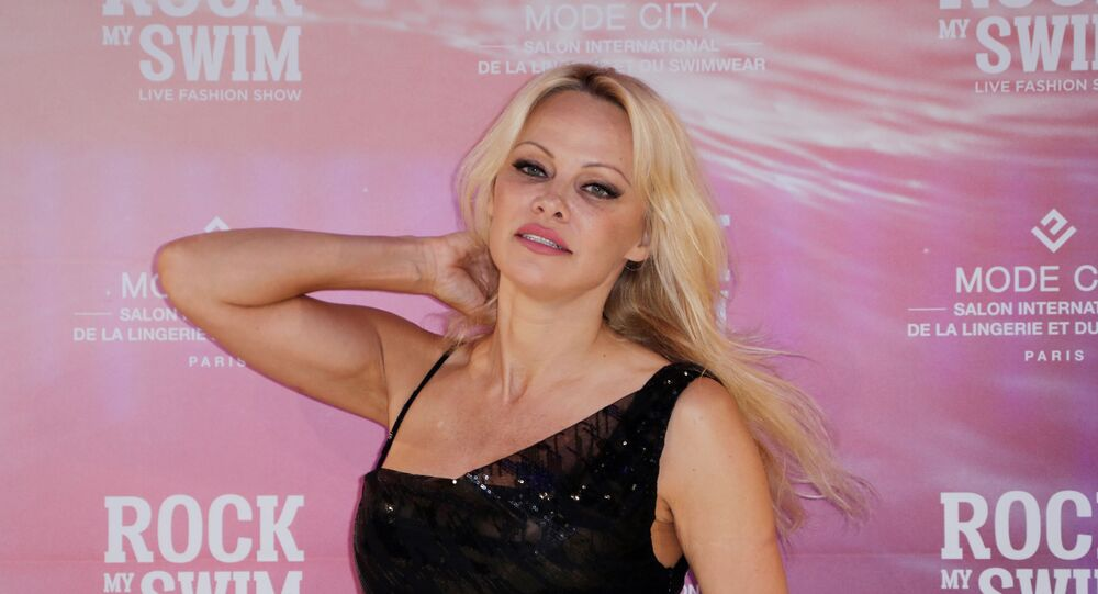 US actress Pamela Anderson poses before attending the Rock My Swim by Mode City Paris fashion show in Paris on July 8, 2017
