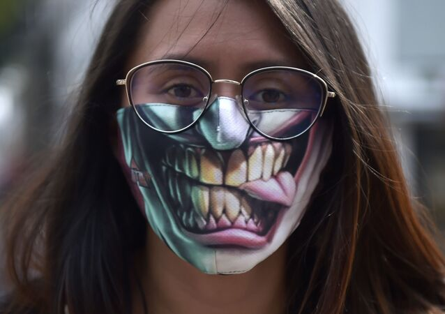 A woman uses a face mask as a measure against the spread of the new coronavirus, COVID-19, in Bogota, Colombia on 19 March 2020.