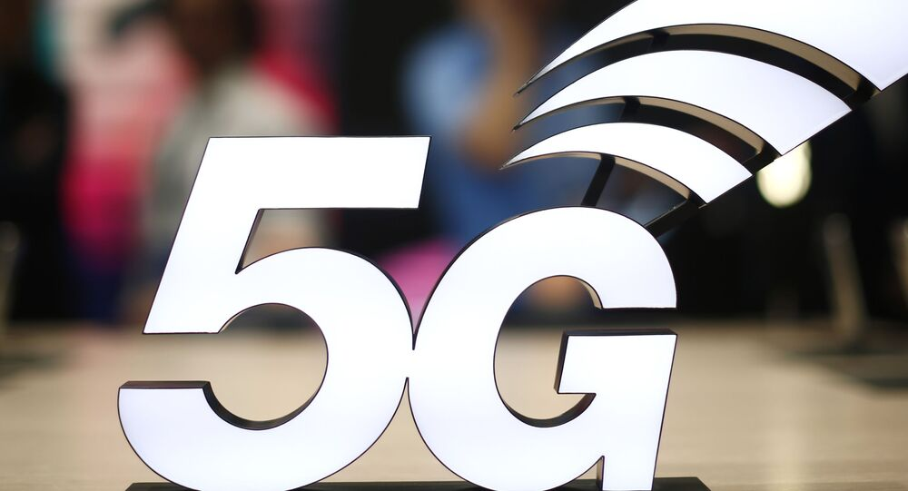 FILE - This Feb. 25, 2019 file photo shows a banner of the 5G network is displayed during the Mobile World Congress wireless show, in Barcelona, Spain.
