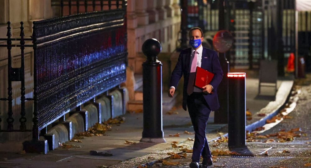 Britain's Health Secretary Matt Hancock wears an NHS face mask outside 10 Downing Street, in London, Britain, 16 November 2020