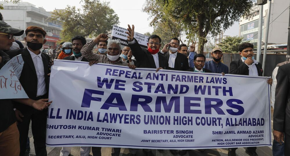 Lawyers march in support of farmers during a nationwide farmers' strike in Prayagraj, Tuesday, Dec. 8, 2020