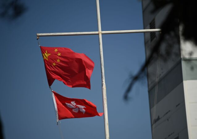 The Chinese (top) and Hong Kong flags flutter in Hong Kong on December 5, 2020.