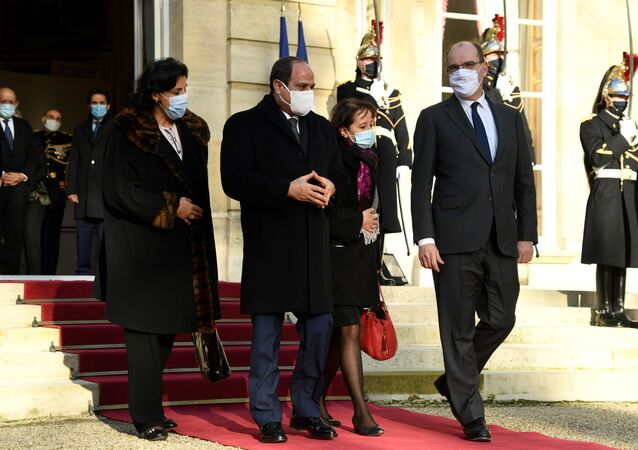 French Prime Minister Jean Castex (R) escorts Egyptian president Abdel Fattah al-Sisi (C) out of the Matignon hotel following their meeting, on 8 December 2020 in Paris, as part of al-Sisi's three-day visit to France.