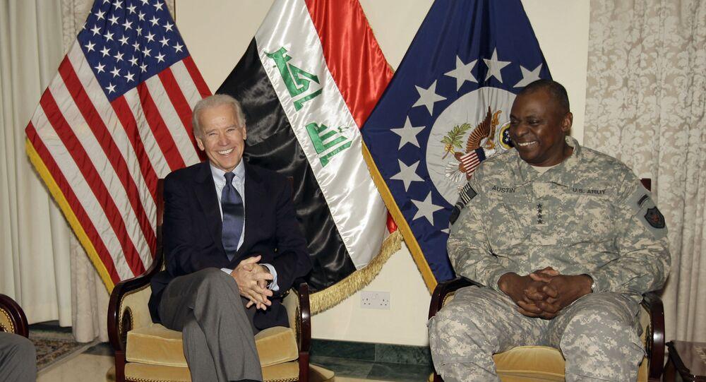 Joe Biden, left, is seen with Gen. Lloyd Austin, the top U.S. commander in Iraq, in Baghdad, Iraq, Tuesday, Nov. 29, 2011