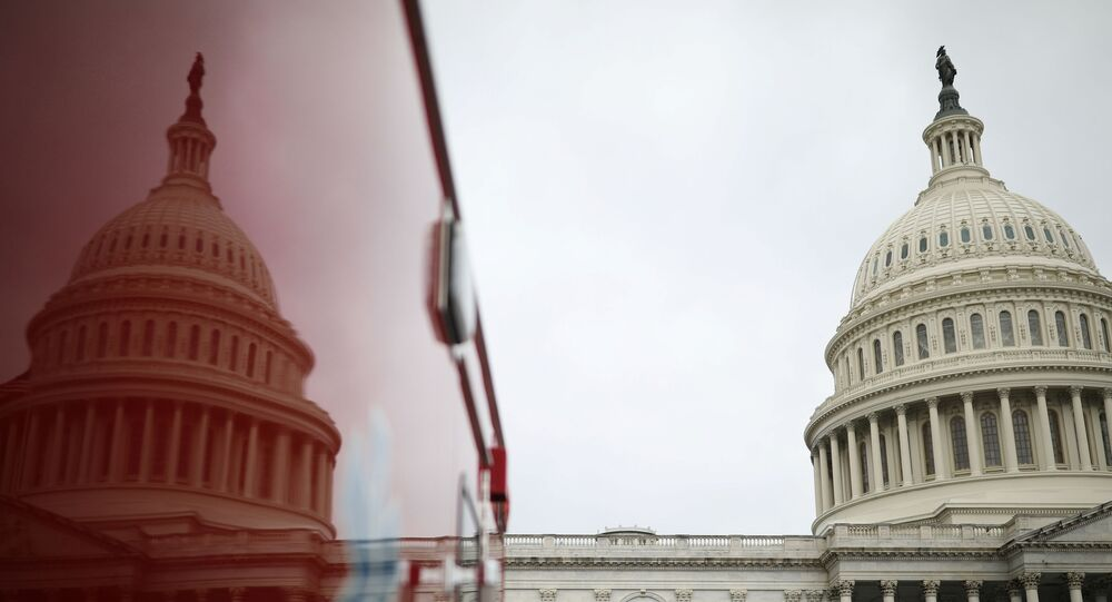 The U.S. Capitol Building is reflected on an ambulance on Capitol Hill in Washington, U.S., December 4, 2020.
