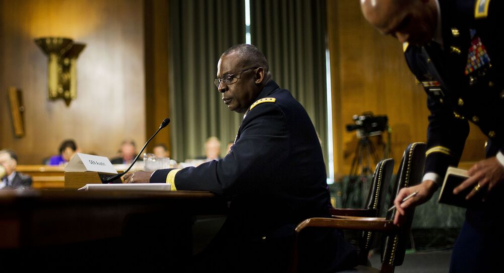 US Central Command Commander Gen. Lloyd Austin III, center seated, looks back to his military aide while testifying on Capitol Hill in Washington, Wednesday, Sept. 16, 2015, before the Senate Armed Services Committee hearing on 'US military operations to counter the Islamic State in Iraq'.