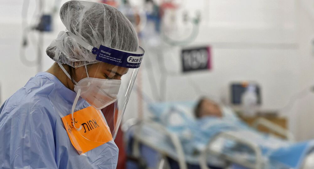 A member of the medical staff wearing protective gear works at the coronavirus ward of the Rambam Health Care Campus, initially built as an underground medical facility before being converted to a car park, then to a center to receive patients as COVID-19 cases surge, in the northern Israeli city of Haifa on October 11, 2020.