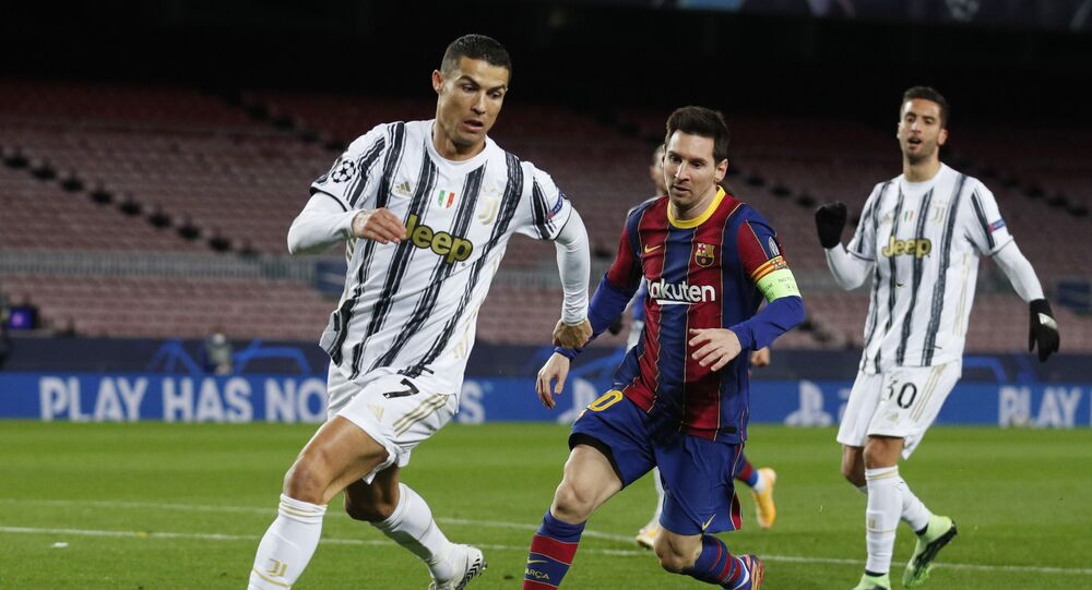Soccer Football - Champions League - Group G - FC Barcelona v Juventus - Camp Nou, Barcelona, Spain - December 8, 2020 FC Barcelona's Lionel Messi in action with Juventus' Cristiano Ronaldo
