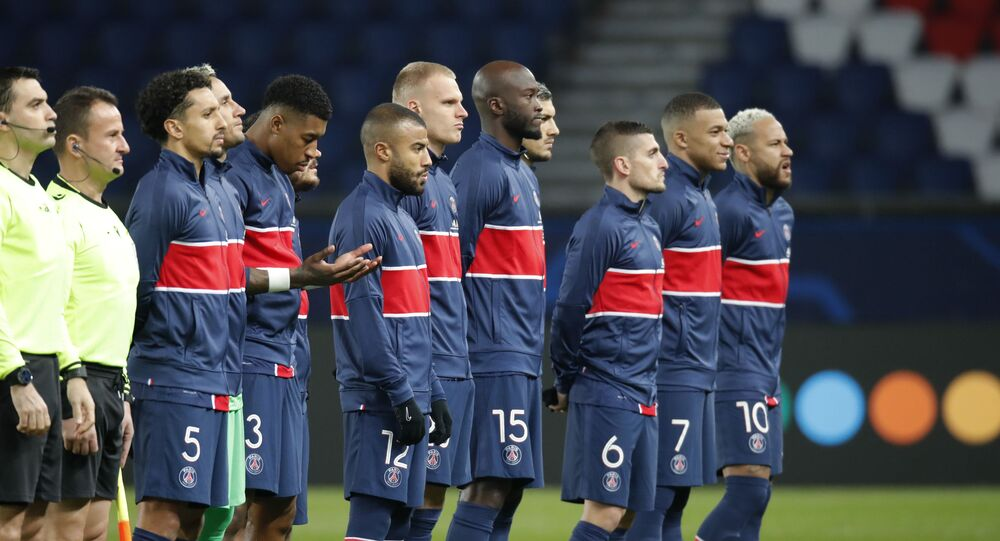 Paris St Germain players line up before the match