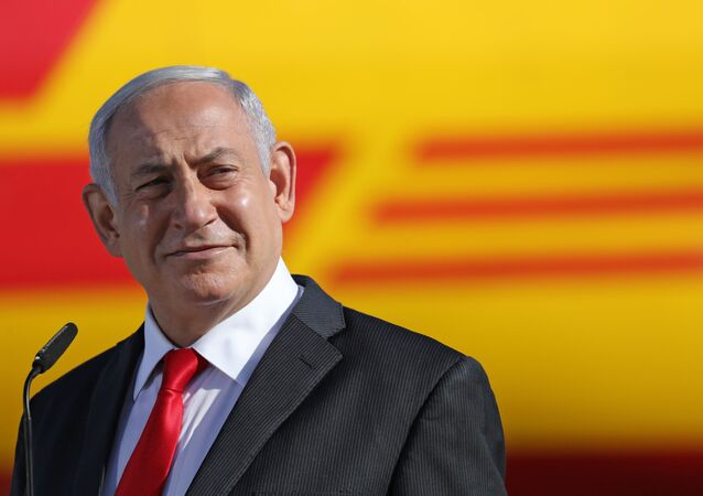 Israeli Prime Minister Benjamin Netanyahu attends a ceremony to mark the arrival of a plane of the international courier company DHL, carrying over 100,000 of doses of the first batch of Pfizer vaccines which landed at Ben Gurion Airport near Tel Aviv, on December 9, 2020.
