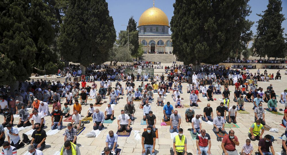 Worshippers Gather for Eid al-Fitr Prayers Outside Al-Aqsa Mosque in Jerusalem Amid Tensions
