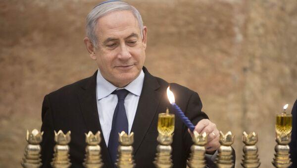 Israeli Prime Minister Benjamin Netanyahu, lights a Hanukkah candle at the Western Wall, the holiest site where Jews can pray in Jerusalem's old city, Sunday, 22 December 2019. - Sputnik International