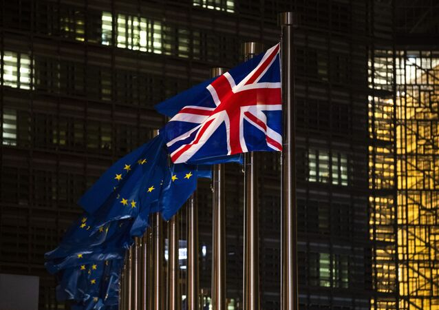 The Union Flag and European Union flags flap in the wind prior a meeting between European Commission President Ursula von der Leyen and British Prime Minister Boris Johnson at EU headquarters in Brussels, Wednesday, Dec. 9, 2020