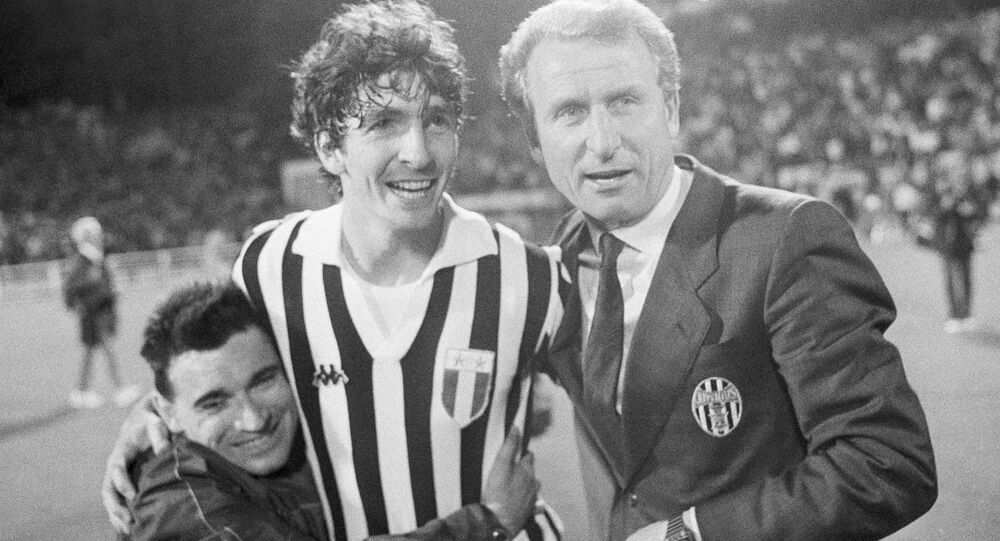 Juventus star Paolo Rossi is embraced by a fan as he stands with manager Giovanni Trapattoni after winning the 1985 European Cup.