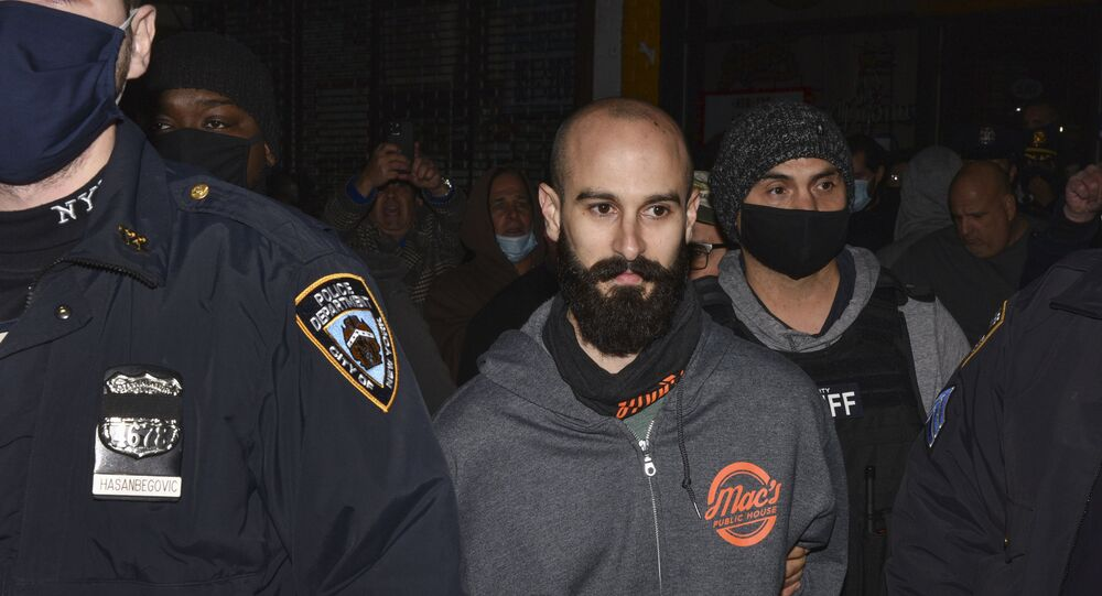 Mac's Public House co-owner Danny Presti is taken away in handcuffs after being arrested by New York City sheriff's deputies, Tuesday, Dec. 1, 2020, in the Staten Island borough of New York