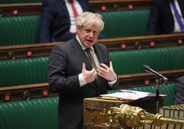 A handout photograph released by the UK Parliament shows Britain's Prime Minister Boris Johnson speaking during Prime Minister's Questions (PMQs) in the House of Commons, in central London on December 9, 2020.
