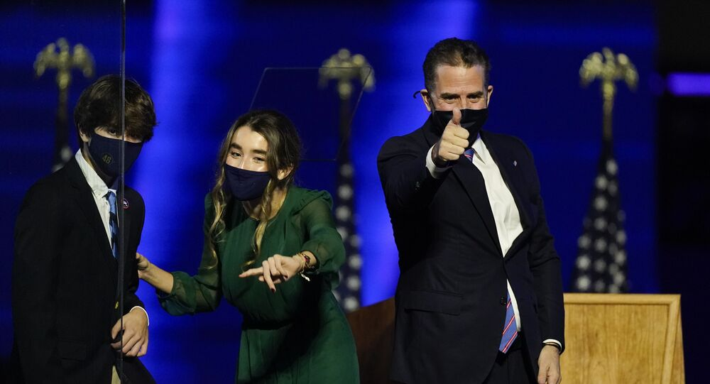 Hunter Biden, son of President-elect Joe Biden gives a thumbs-up as he stands on stage Saturday, Nov. 7, 2020, in Wilmington, Del.