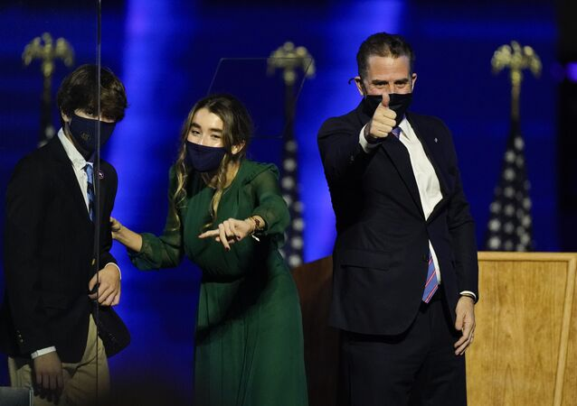 Hunter Biden, son of President-elect Joe Biden gives a thumbs-up as he stands on stage Saturday, 7 November 2020, in Wilmington, Delaware.