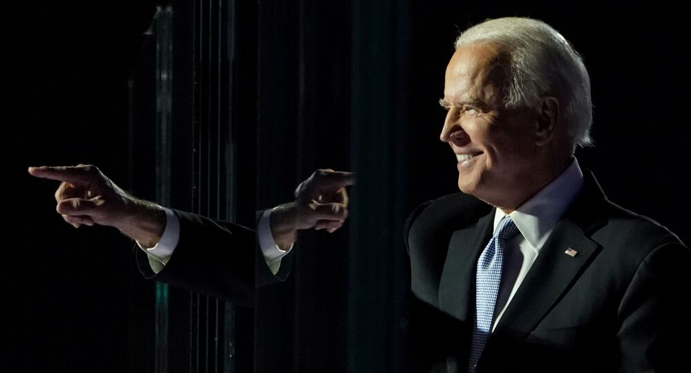 Democratic 2020 U.S. presidential nominee Joe Biden points a finger at his election rally, after news media announced that Biden has won the 2020 U.S. presidential election, in Wilmington, Delaware, U.S., November 7, 2020.