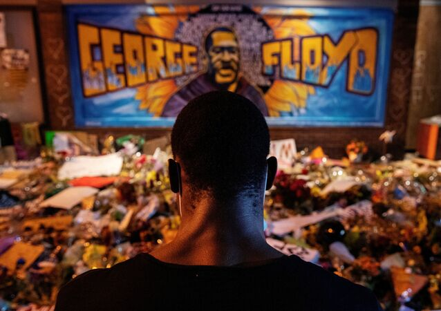 A man recites spoken word poetry at a makeshift memorial honoring George Floyd, at the spot where he was taken into custody, in Minneapolis, Minnesota, U.S., June 1, 2020