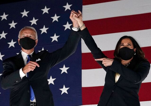 (FILES) In this file photo taken on August 20, 2020 Former vice-president and Democratic presidential nominee Joe Biden (L) and Senator from California and Democratic vice presidential nominee Kamala Harris greet supporters outside the Chase Center in Wilmington, Delaware, at the conclusion of the Democratic National Convention, held virtually amid the novel coronavirus pandemic.