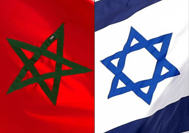 (COMBO) This combination of file pictures created on December 10, 2020 shows a Moroccan flag off the coasts of the city of Cayenne on March 21, 2012 and an Israeli national flag on September 23, 2020