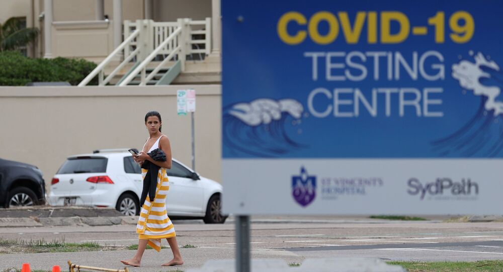 Australia stops COVID-19 vaccine trials as many volunteers generate HIV antibodies