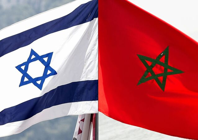 This combination of file pictures created on December 10, 2020 shows a Moroccan flag off the coasts of the city of Cayenne on March 21, 2012 and an Israeli national flag on September 23, 2020