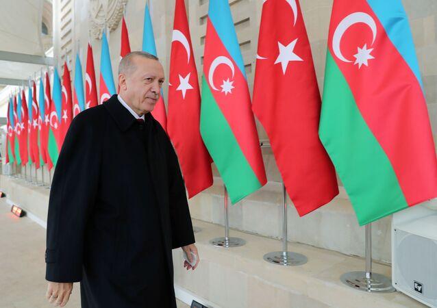 Turkish President Tayyip Erdogan arrives at a military parade to mark the victory on Nagorno-Karabakh conflict, in Baku, Azerbaijan December 10, 2020. Murat Cetinmuhurdar/Presidential Press Office/Handout via REUTERS