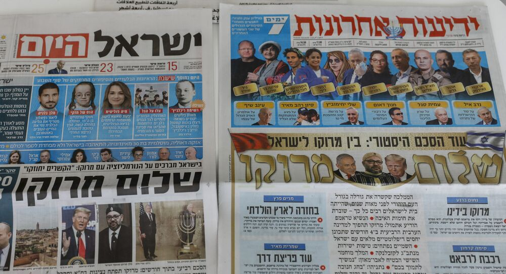 This picture taken on December 11, 2020 in Jerusalem shows Israeli newspapers' front page titles about the announcement that Israel is to establish diplomatic relations with Morocco. - Outgoing President Donald Trump's double announcement of a normalisation of ties between Morocco and Israel and US recognition of Moroccan sovereignty over Western Sahara has prompted mixed reactions. In a statement by the royal palace, Morocco's King Mohammed VI confirmed on December 10 that his country would resume official contacts.... and diplomatic relations with minimal delay with Israel, two decades after the two countries closed liaison offices.