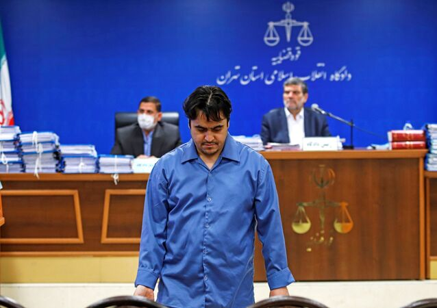 Ruhollah Zam, a dissident journalist who was captured in what Tehran calls an intelligence operation, is seen during his trial in Tehran, Iran, 2 June 2020.