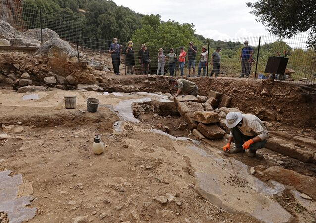Employees with Israel Nature and Parks Authority are pictured during preservation work of a Hellenistic, Roman and the Byzantine periods site, at the Banias Nature Reserve in the Israeli-annexed Golan Heights on November 11, 2020. - A church from the Byzantine period built on the basis of a temple to the Greek god Pan was discovered in the Banias Springs Reserve. The church that was discovered dates back to the fourth-fifth centuries AD, when the ancient city of Nias was an important Christian centre with a bishop, after having previously been a significant ritual centre for El Pan in the Hellenistic and Roman periods. (Photo by MENAHEM KAHANA / AFP)
