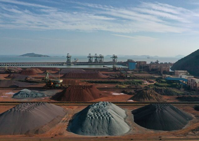 Piles of imported iron ore are seen at a port in Zhoushan in the eastern Chinese province of Zhejiang.