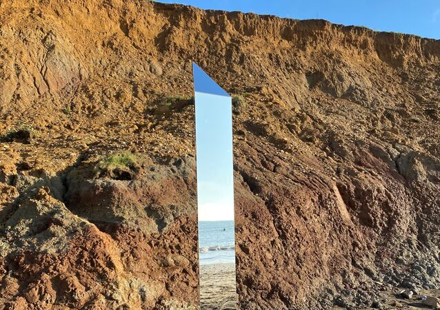 Shining metal object is seen at Compton Beach, Isle of Wight, Britain December 6, 2020. Picture taken December 6, 2020.
