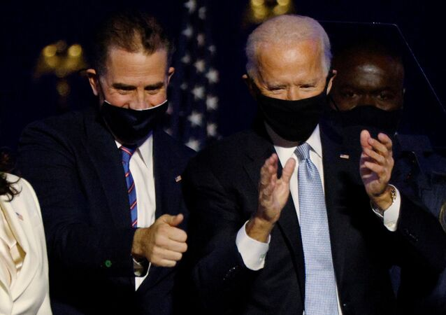 Democratic 2020 U.S. presidential nominee Joe Biden and his son Hunter celebrate onstage at his election rally, after the news media announced that Biden has won the 2020 U.S. presidential election over President Donald Trump, in Wilmington, Delaware, U.S., November 7, 2020.