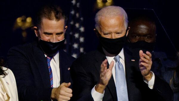 Democratic 2020 U.S. presidential nominee Joe Biden and his son Hunter celebrate onstage at his election rally, after the news media announced that Biden has won the 2020 U.S. presidential election over President Donald Trump, in Wilmington, Delaware, U.S., November 7, 2020. - Sputnik International