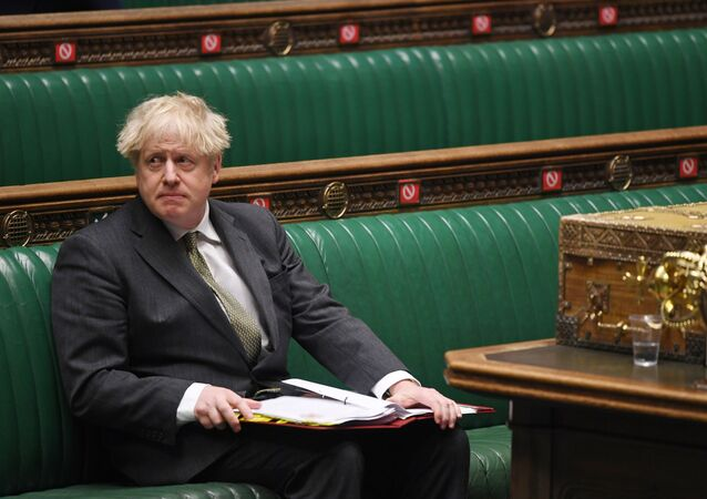 Britain's Prime Minister Boris Johnson looks on during Question Period at the House of Commons in London, Britain December 9, 2020.
