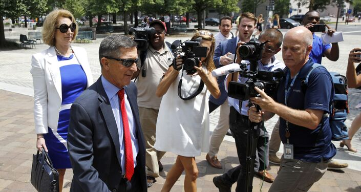 Michael Flynn, left, President Donald Trump's former national security adviser, departs a federal courthouse after a hearing, Monday, June 24, 2019, in Washington