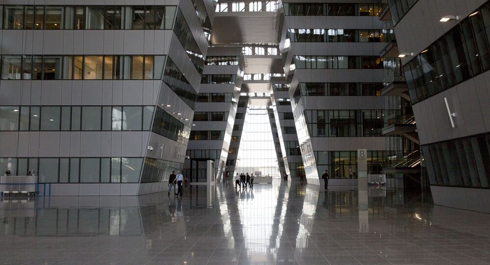 People walk through the Agora atrium at the new NATO headquarters in Brussels on Thursday, April 19, 2018.